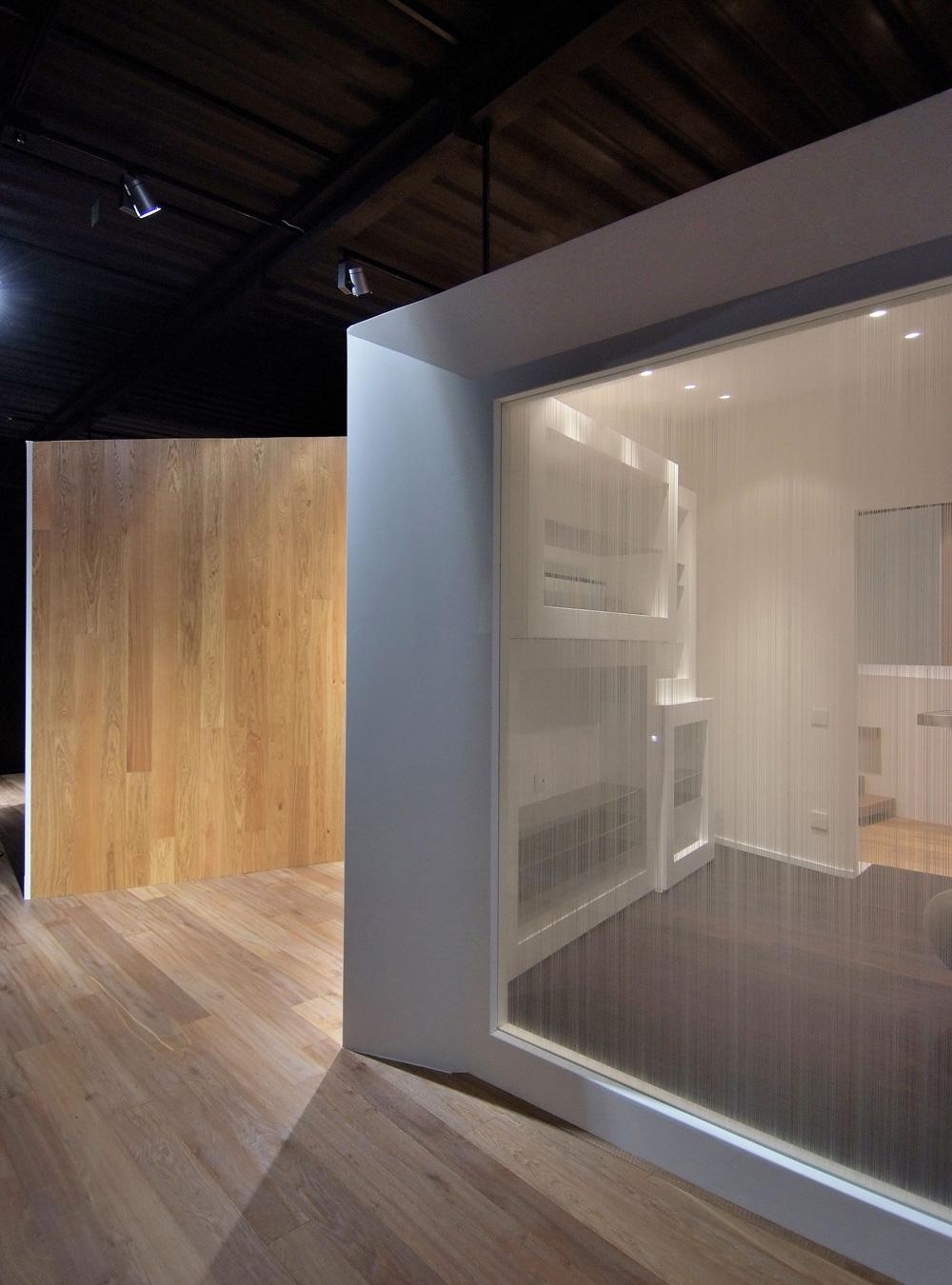 artwood showroom legno e vetro trasparenze